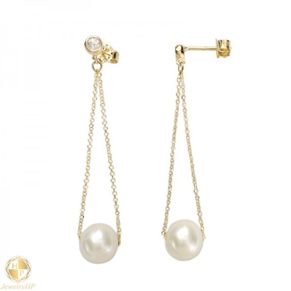Gold hanging pearl earrings on a chain with gemstone